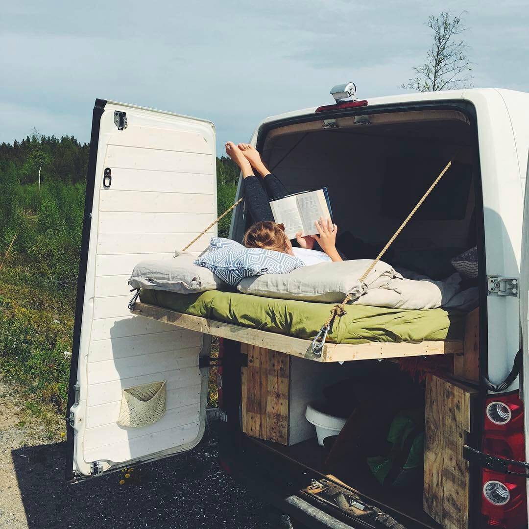 diy platform bed design in a camper conversion for living in a van
