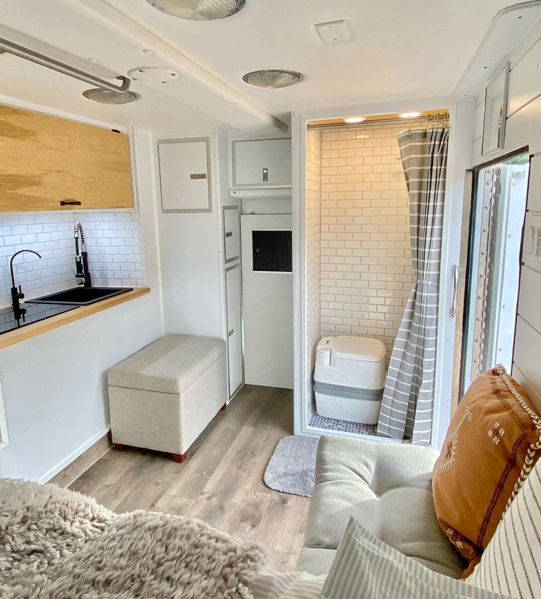 beautiful camper van conversion with a bathroom inside