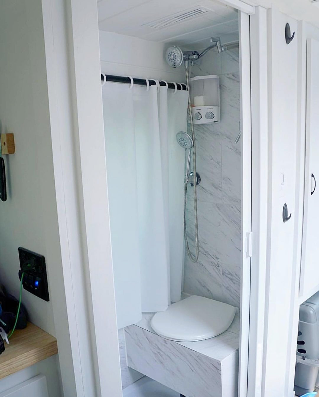 camper van with a toilet and shower wet room inside