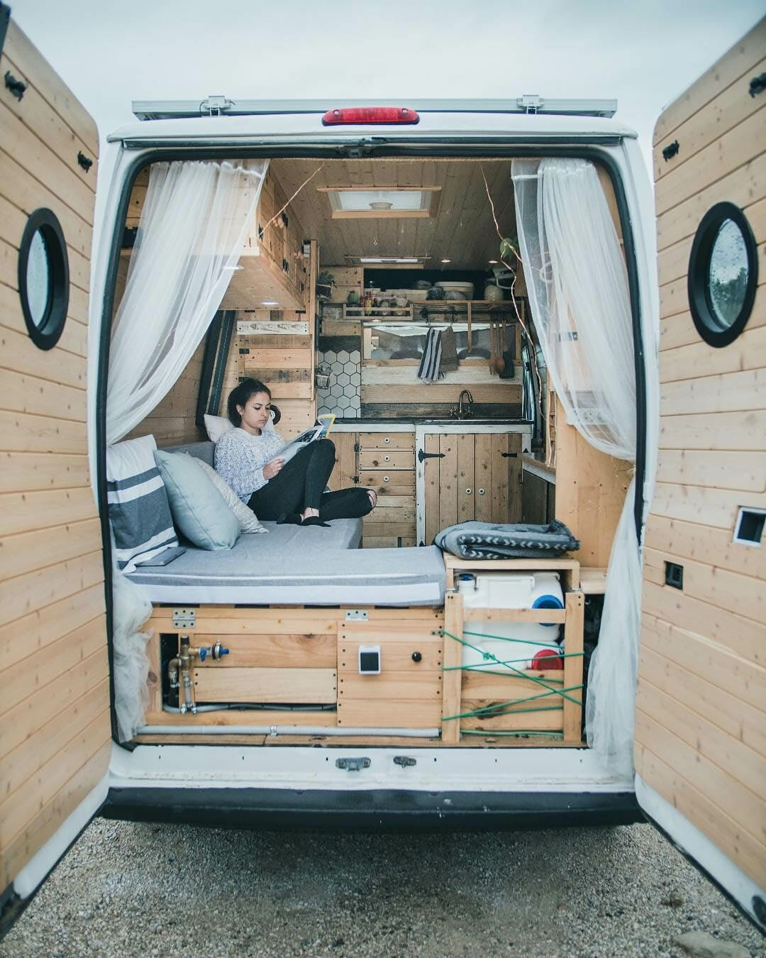 sitting in a custom campervan conversion build