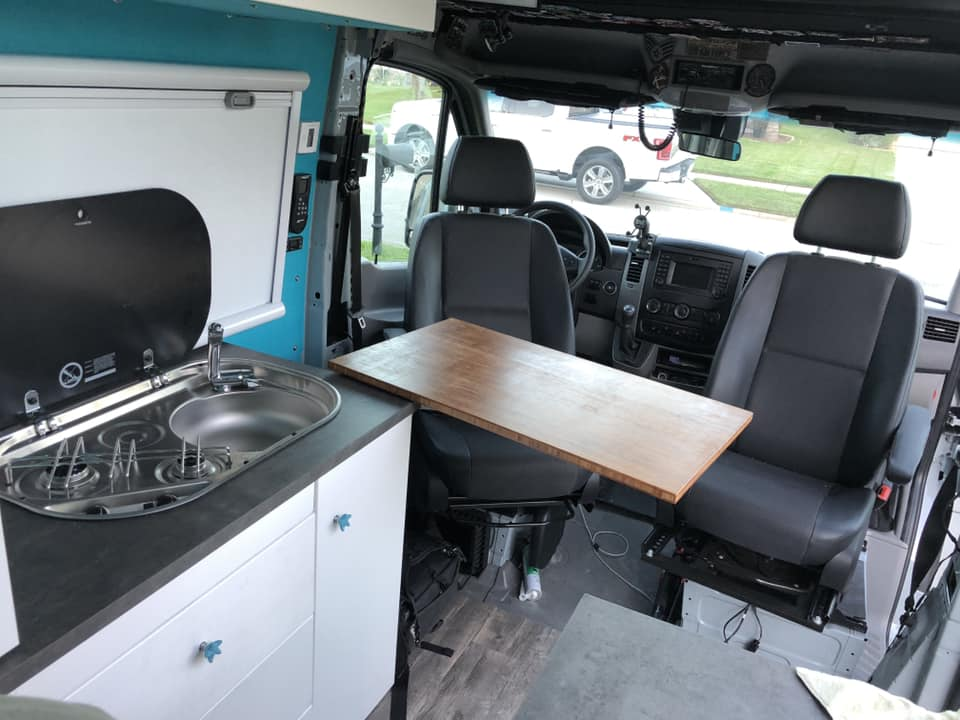swivel seats and table in a diy camper van conversion build