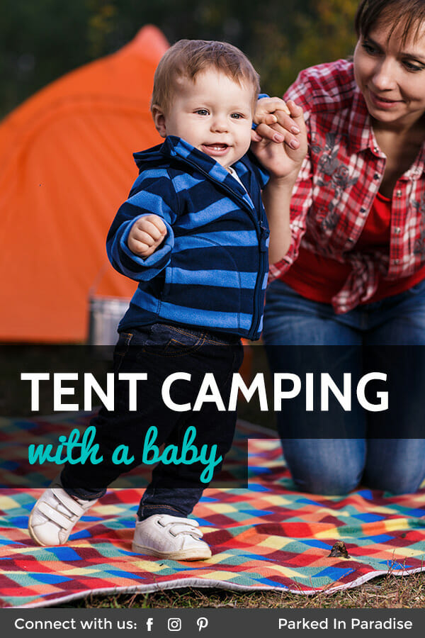 play with baby on a family tent camping trip