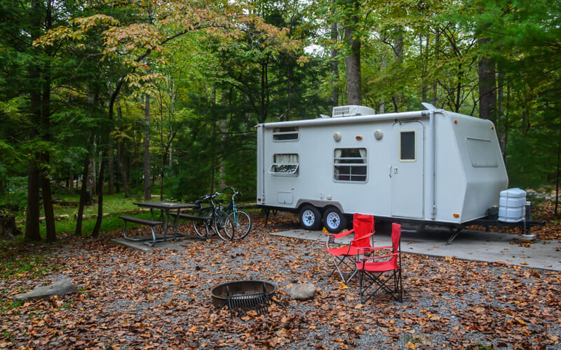 performing rv maintenance on a camping trip
