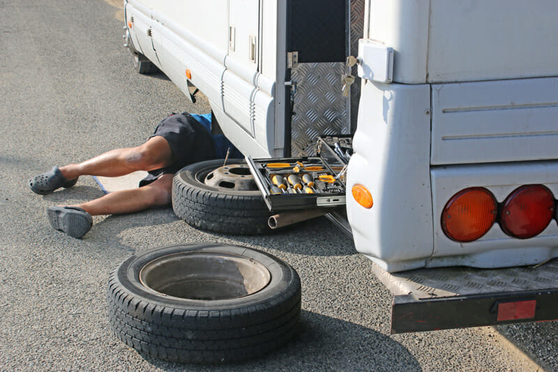 changing a flat tire on an rv camper