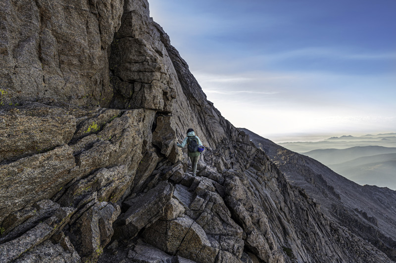 climbing the ledges section of longs peak in rocky mountain national park