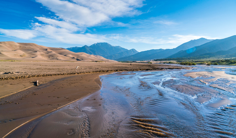 river running through great sand dunes national park in colorado
