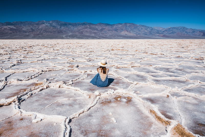 Girl Sitting In The Salt Flats Among The Crystals Of Badwater Basin