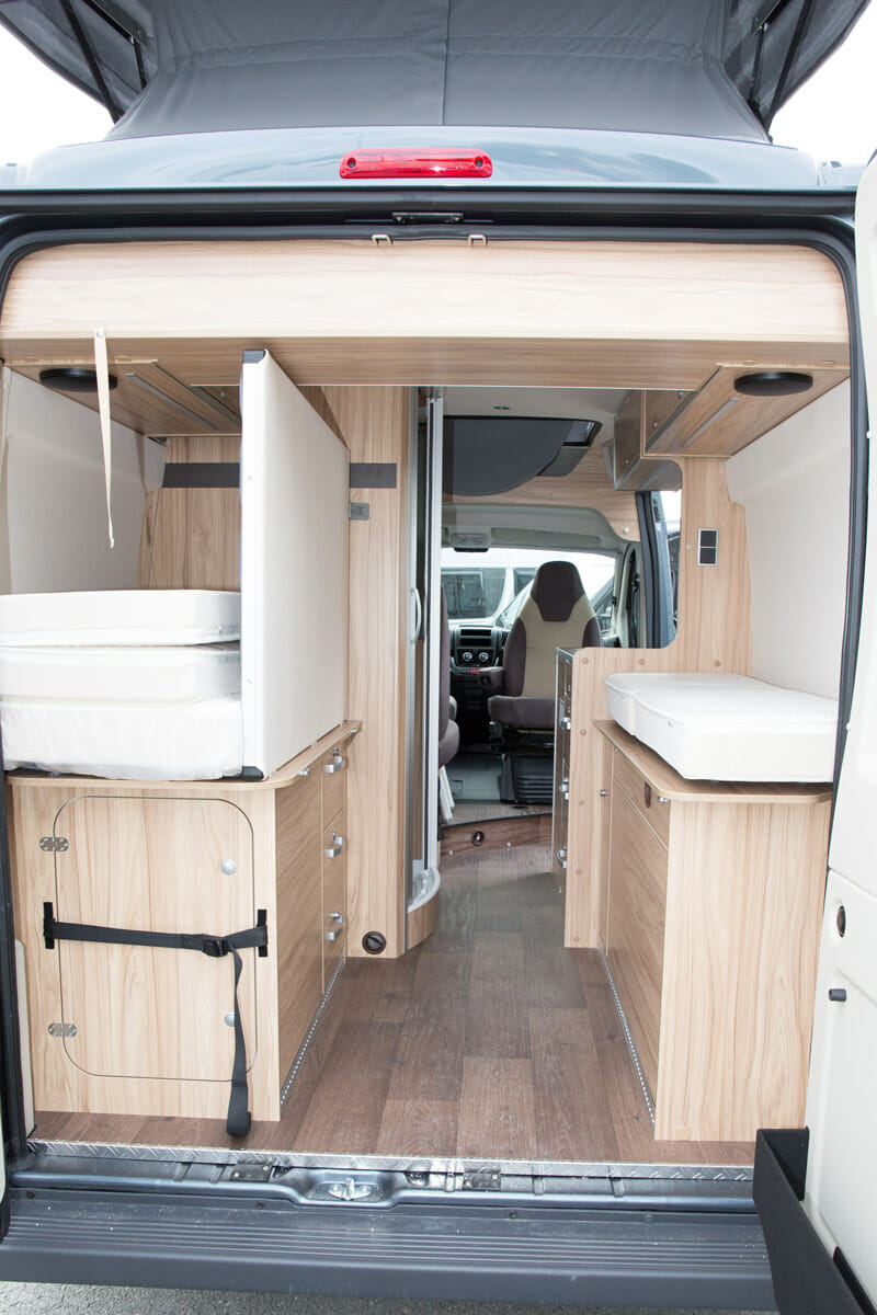 drawbridge style convertible bed in a campervan conversion