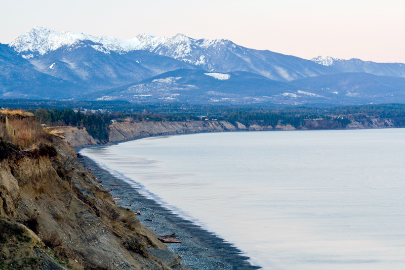 view of dungeness spit and the mountains in olympic national park washington
