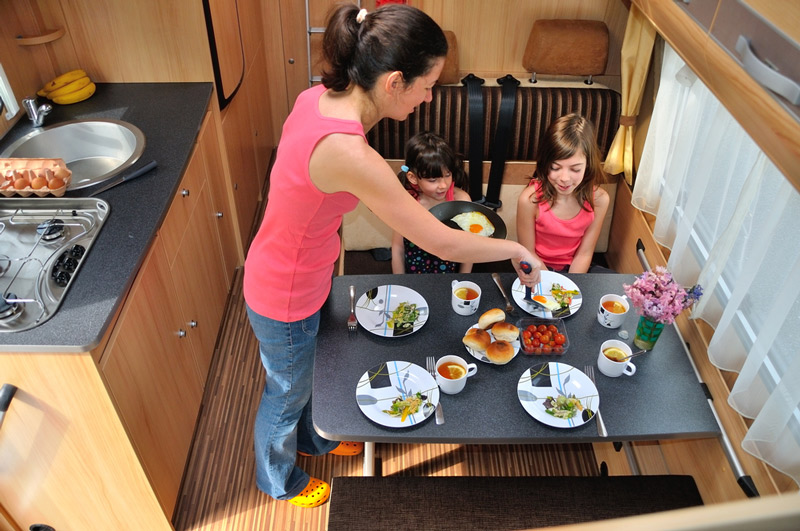 serving dinner on clean plates in an rv