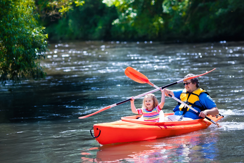 kayaking in tandem with kids