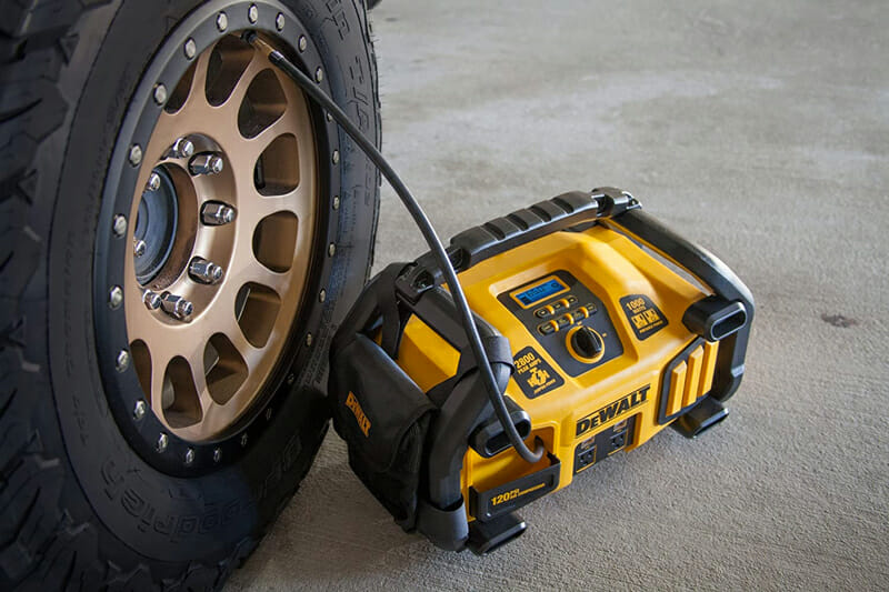 filling a tire using an air compressor on a portable jump starter
