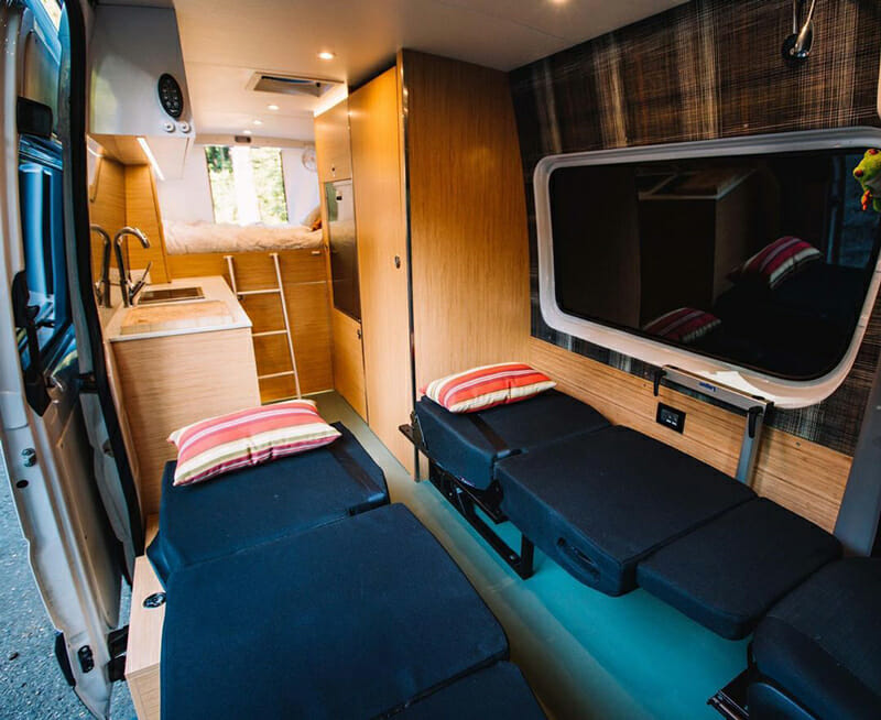 bench seat that folds down into a bed in a camper van