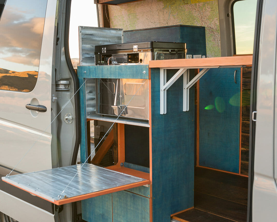 Fold out shelving in a diy camper van conversion