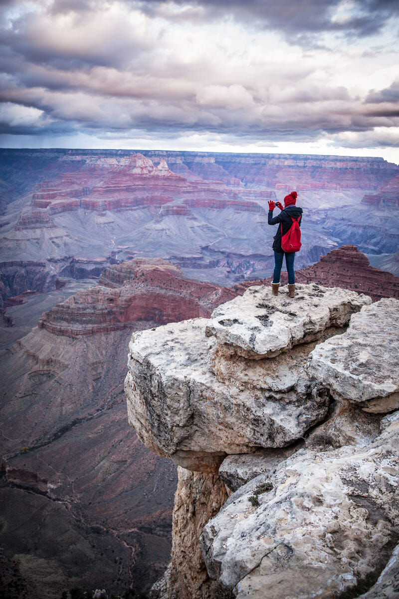 doing photography on an overlook on the grand canyon north rim