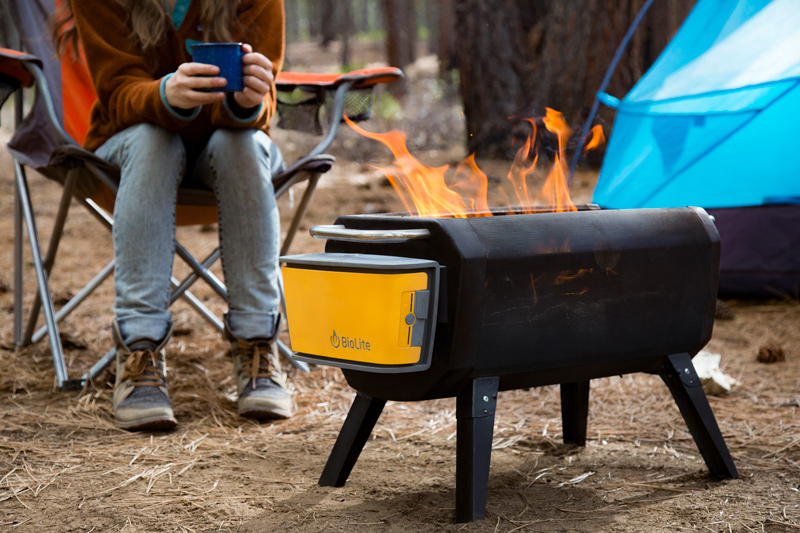 grilling on a portable biolite campfire pit
