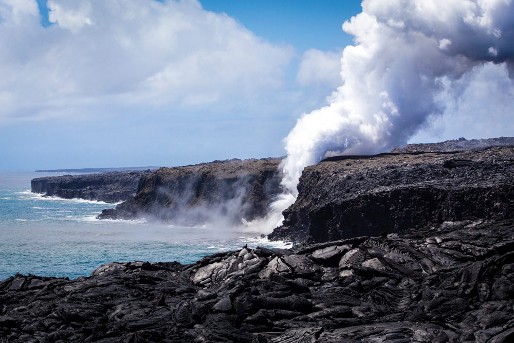 steam rising from the pacific ocean in hawaii volcanos national park