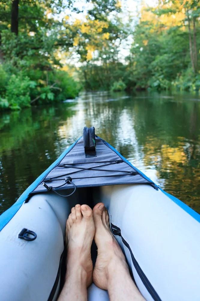 sitting in an inflatable fishing kayak