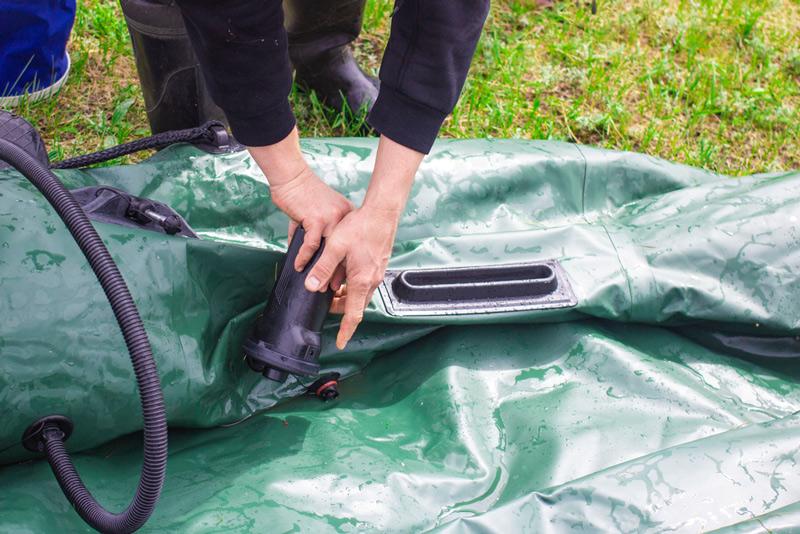 pumping up an inflatable fishing kayak