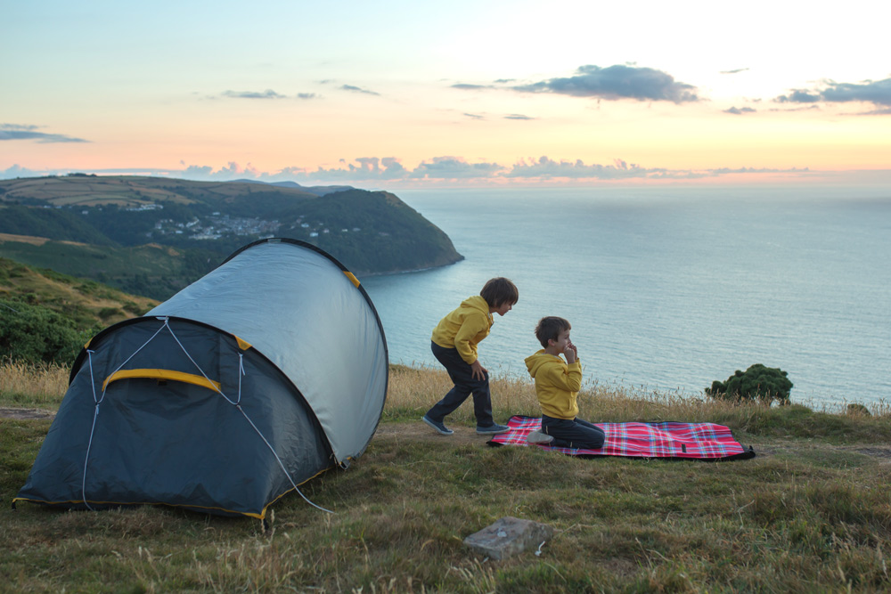 Kids playing near a family sized instant pop up tent
