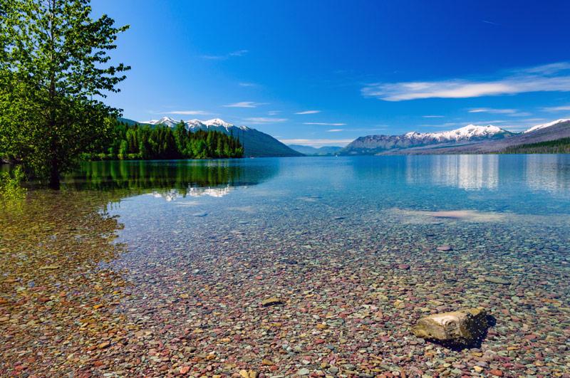 colorful rocks at lake mcdonald in glacier national park