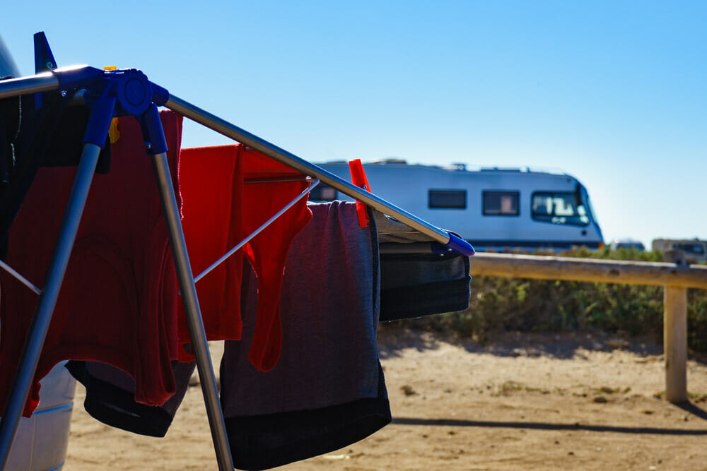 using a portable washing machine to clean clothes outdoors