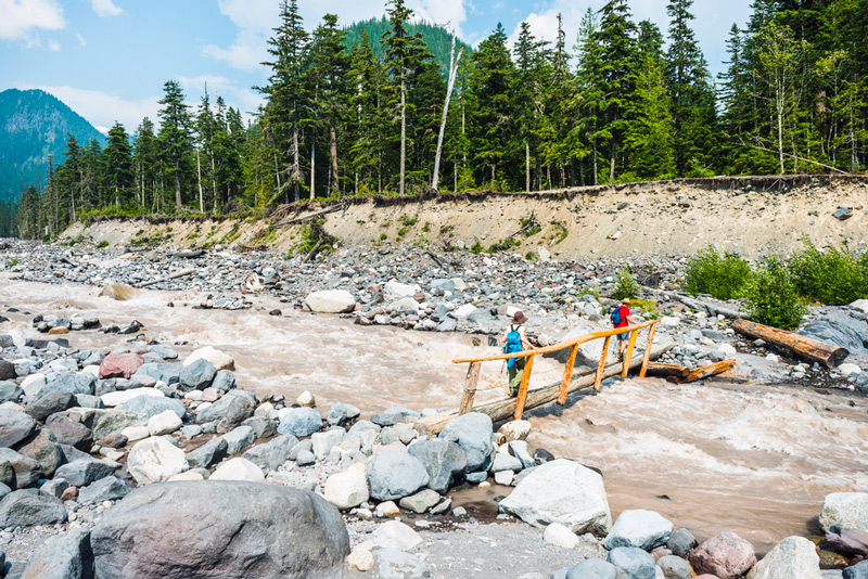crossing the nisqually river in mount rainier national park washington