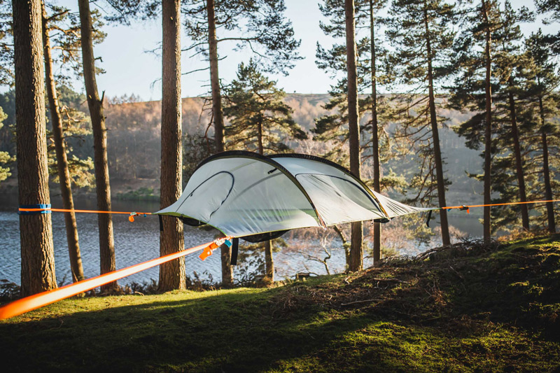 Multi-point tentsile tree tent suspended in the forest