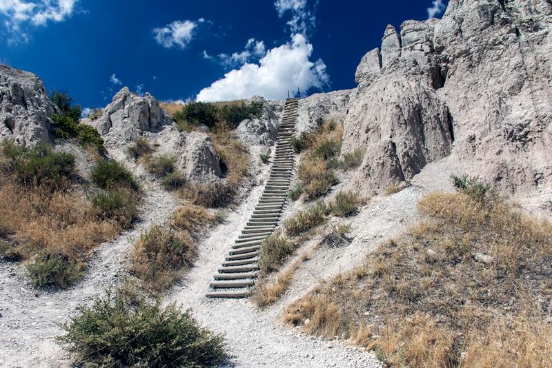 ladder climbing up the notch trail in badlands national park south dakota