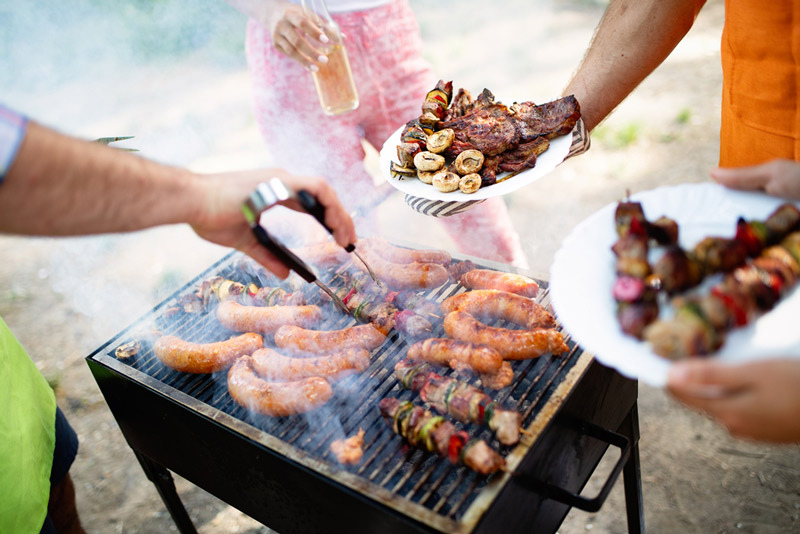 cooking on an outdoor portable grill in an rv park