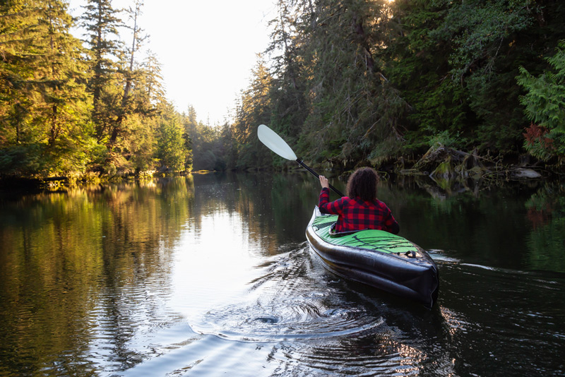 paddling an inflatable kayak in a calm lake