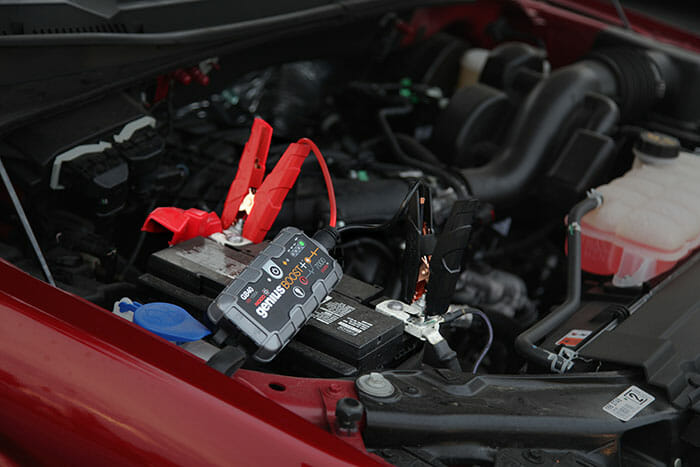 portable jump starter in a pickup truck