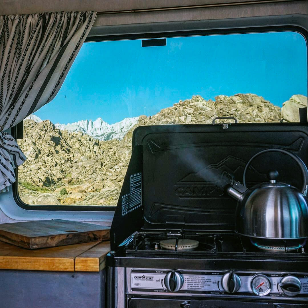 boiling water in a campervan on a portable oven