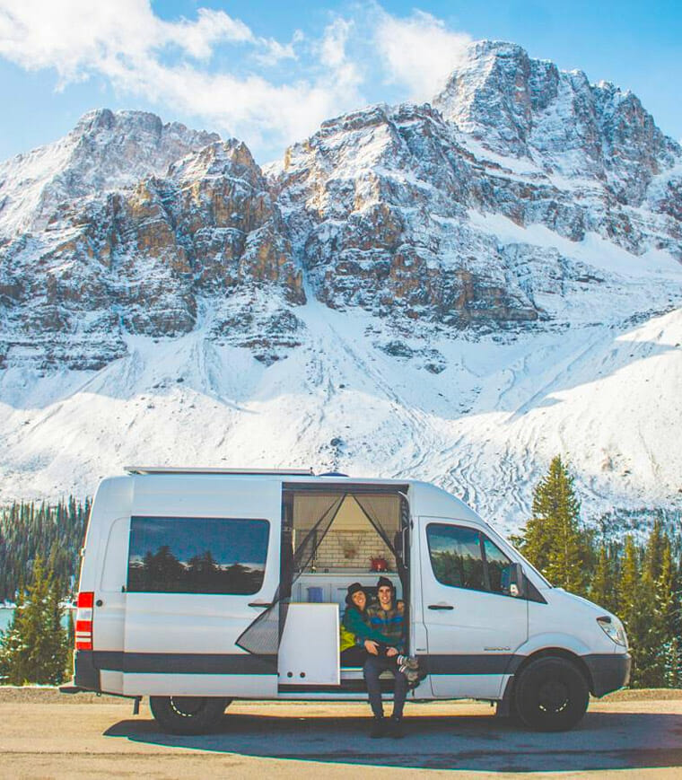 adventuring van couple in the mountains