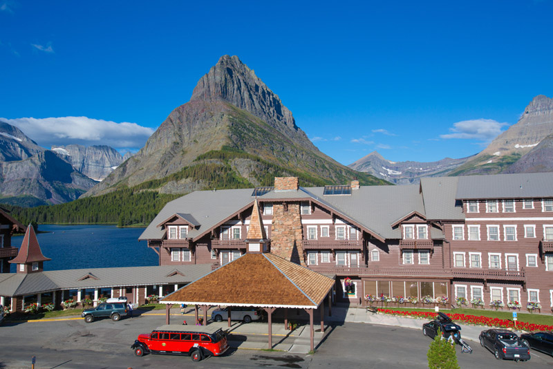red bus tours outside of the many glacier resort and hotel in montana
