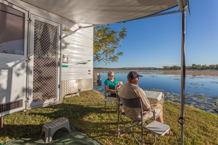 Couple relaxing in an RV rental on vacation
