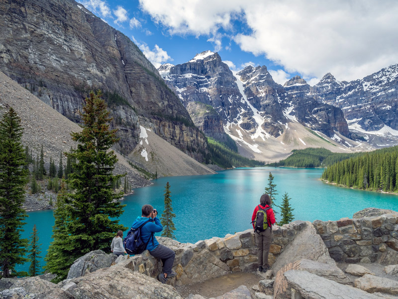 Tourists Visiting Moraine Lake In Rocky Mountain National Park Colorado