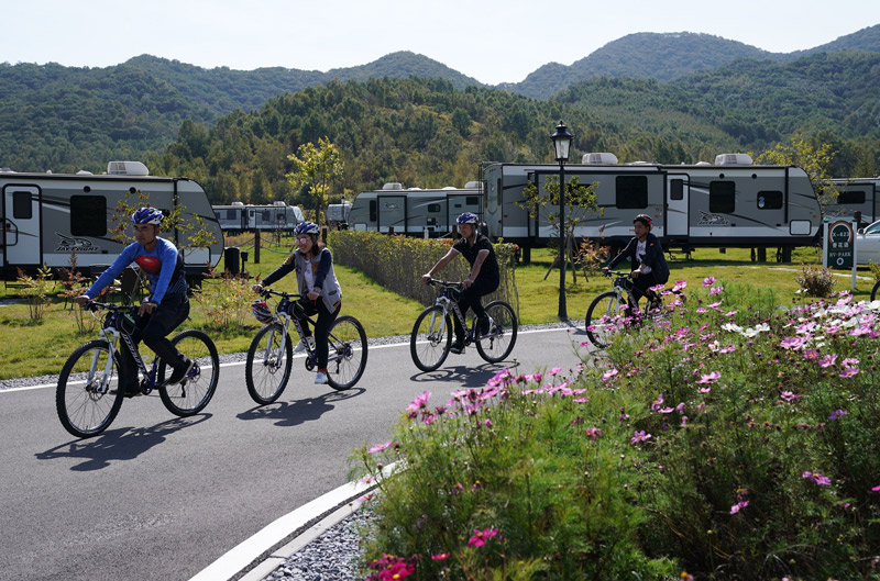 RV campground family bike ride