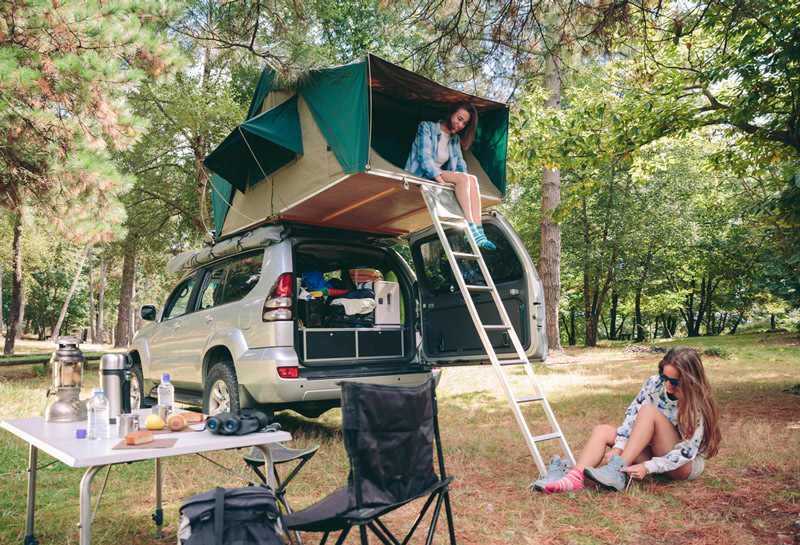 camping with a retractable rv telescoping ladder