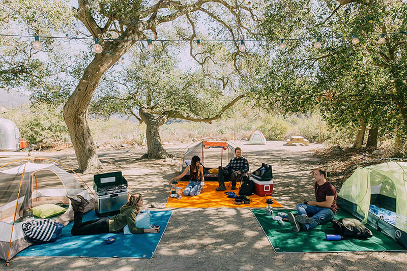tent camping with a sand free outdoor rug