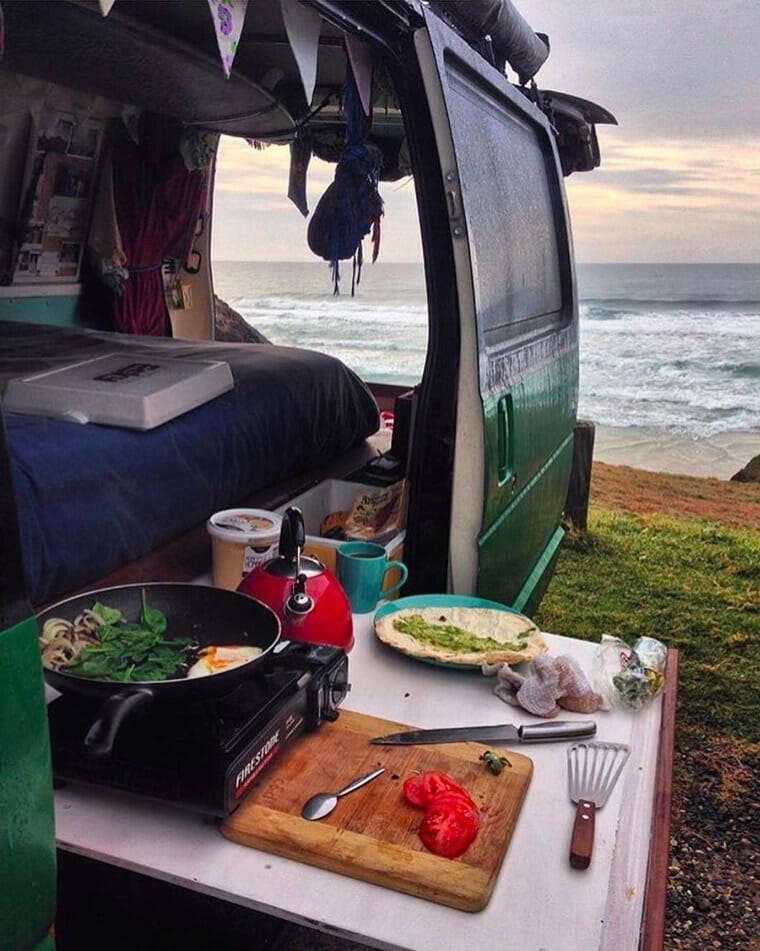 cooking in a van by the beach