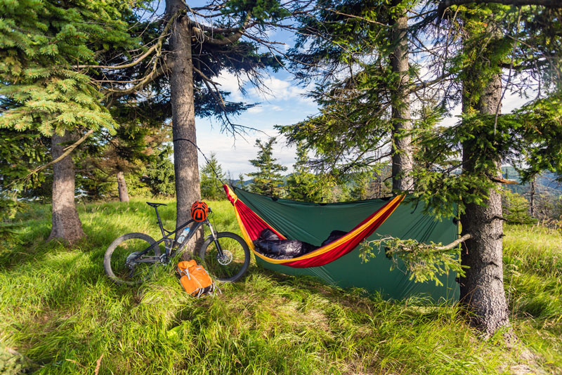 sleeping underneath a shade covered hammock tarp
