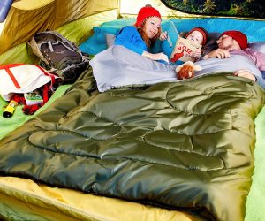 Family Staying Warm In A Tent While Camping With An Extra Large Double Wide Sleeping Bag