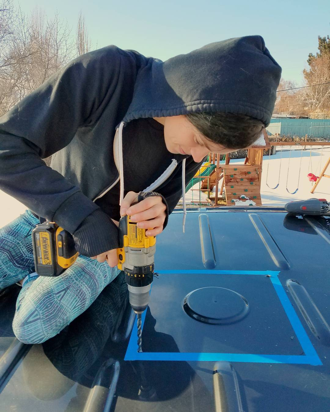 drilling holes in the roof of a campervan