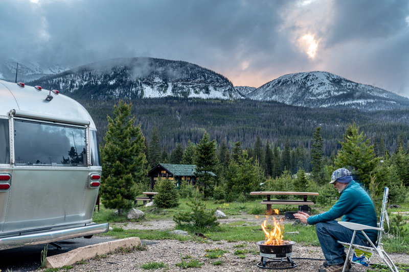 man camping in a trailer at timber creek campground in rocky mountain national park