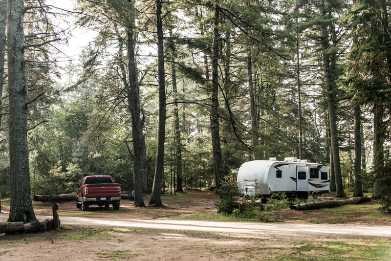 travel trailer using roadside assistance at a campground