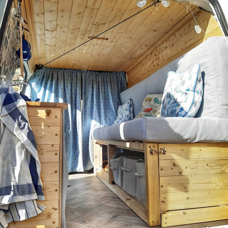 bed and bench design in a ford transit connect camper