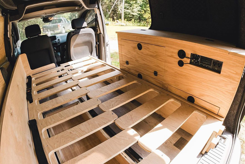 slide out bed design and solar panel installation in a ford transit connect