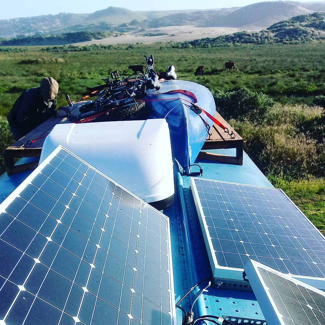 solar panels on top of a skoolie bus build