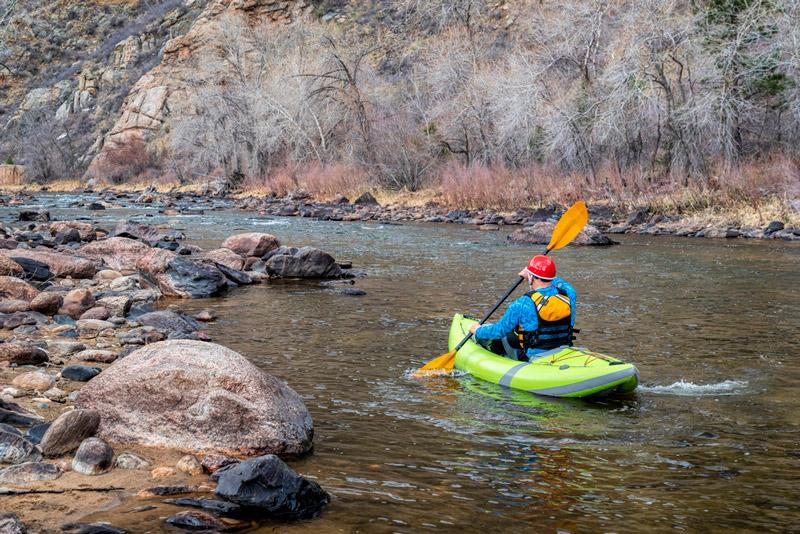 paddling a whitewater kayak